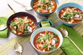 Vegetable Tortilla Soup with Hominy, Avocado & Queso Fresco