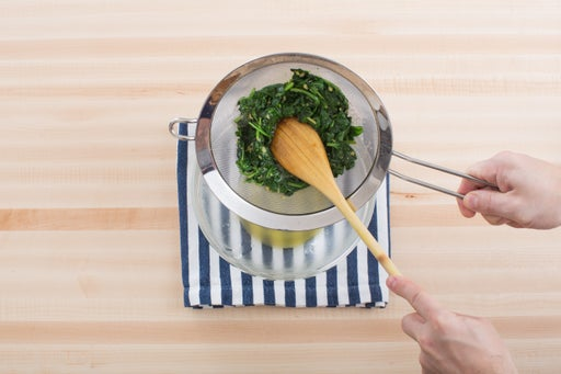 Make the miso-dressed spinach: