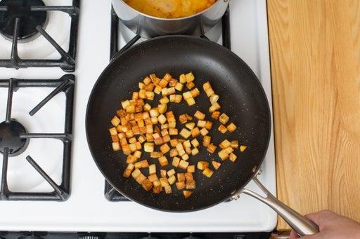 Brown the Yukon gold potatoes: