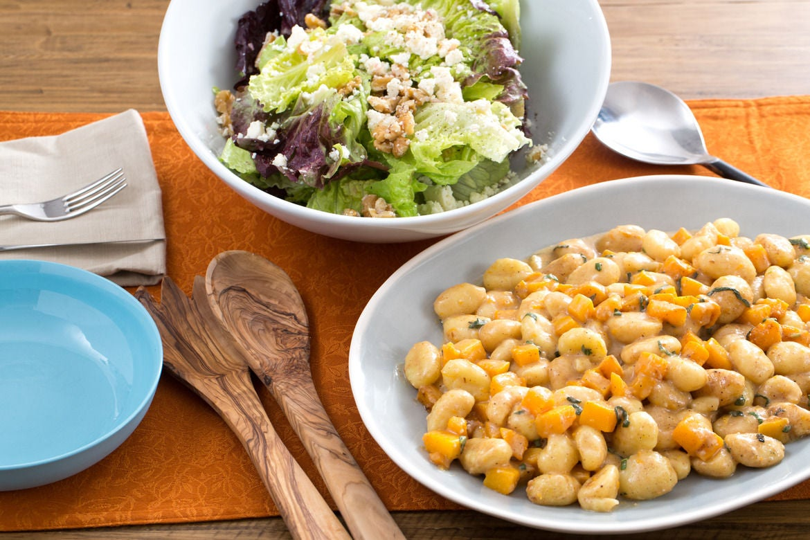 Brown butter butternut squash gnocchi with red leaf lettuce ricotta salata walnut salad