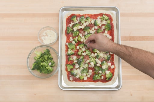 Add the toppings & bake the pizza: