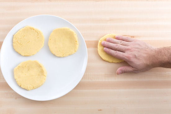 Form the arepas: