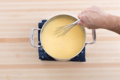 Make the cheesy polenta: