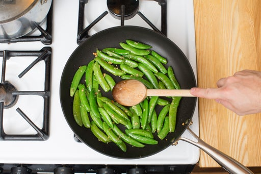 Sauté the snap peas & serve your dish: