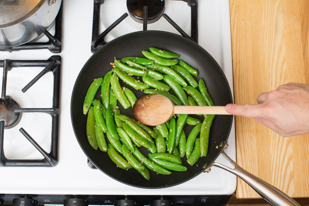 Sauté the snap peas & serve your dish: