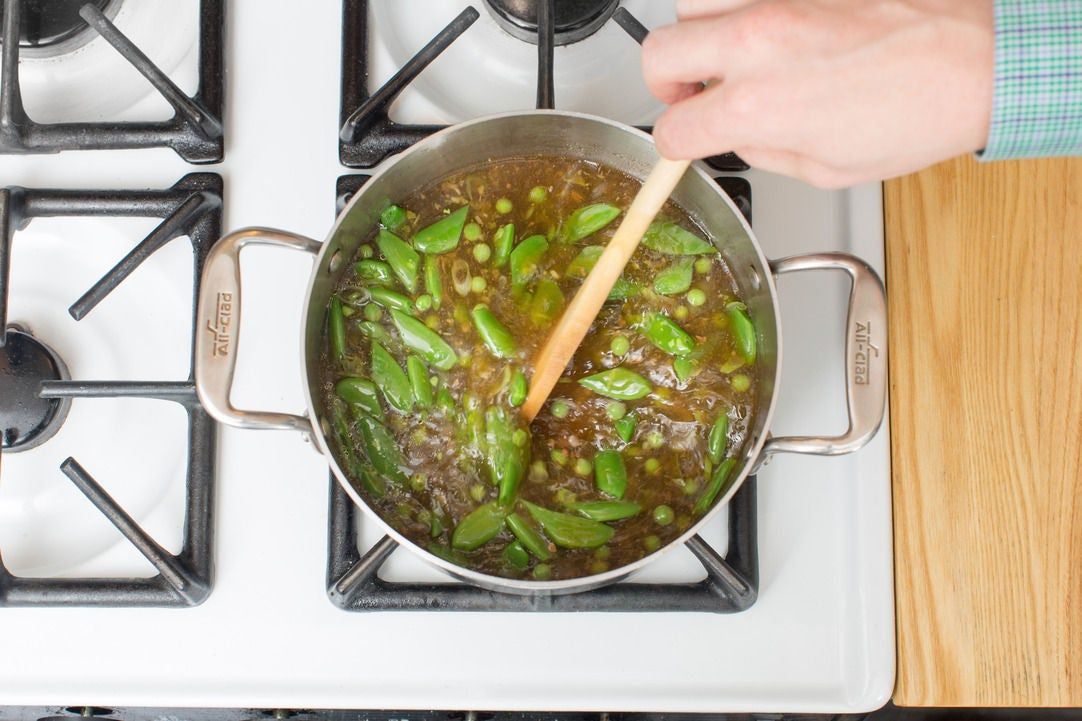 Make the broth & add the peas:
