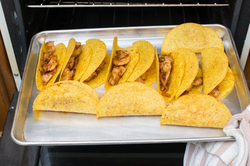 Warm the tacos: