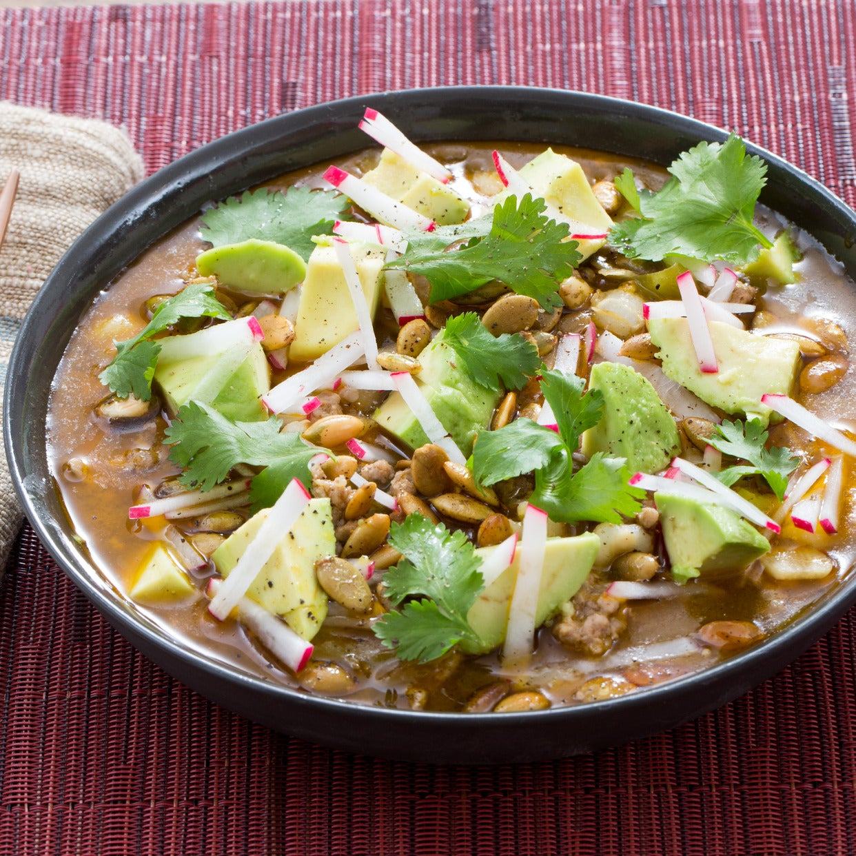 Pork & Tomatillo Pozole with Hominy, Avocado & Radishes