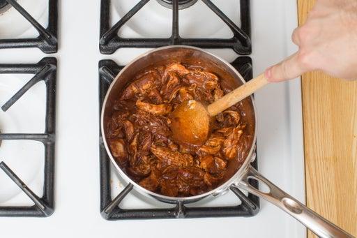 Add the chicken & finish the mole:
