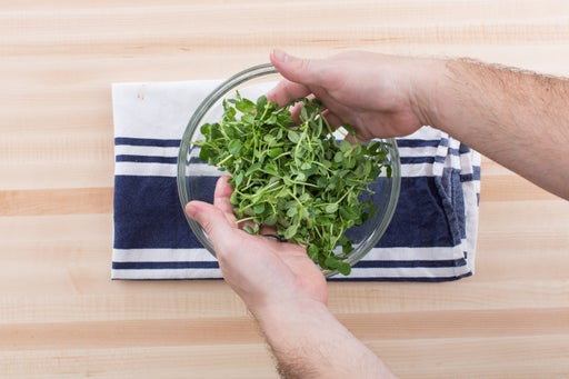 Dress the pea shoots & serve your dish: