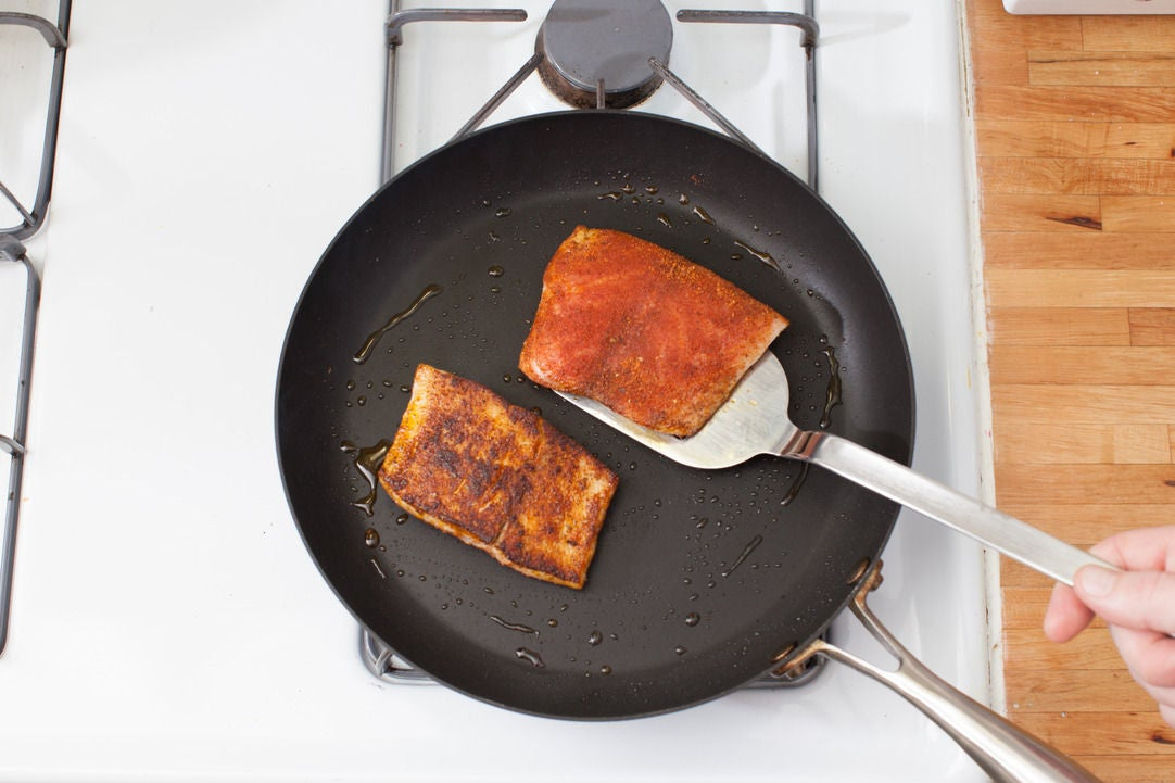 Recipe blackened drum over cheddar cheese grits with for How to cook drum fish