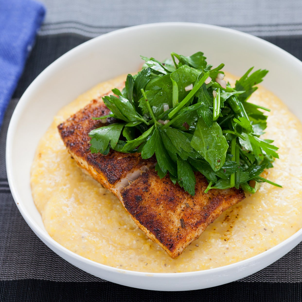 Blackened Drum over Cheddar Cheese Grits with Sorrel, Parsley & Chive Salad