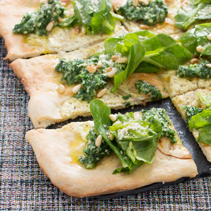White Pizza with Arugula Pesto, Pine Nuts & Pea Tips