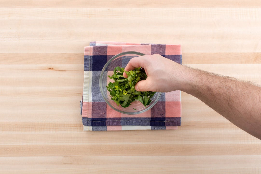 Make the herb salad & plate your dish:
