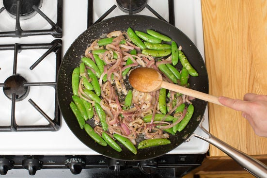 Cook the onion & sugar snap peas: