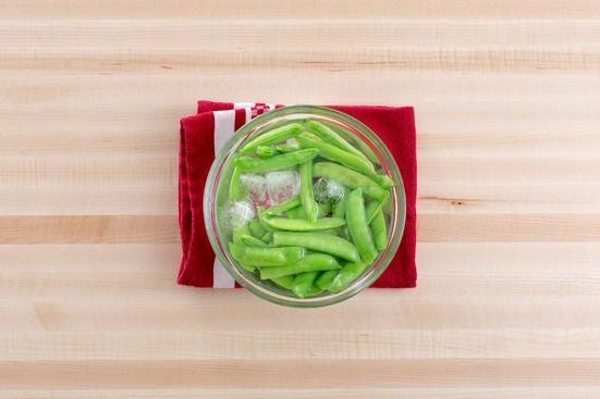 Blanch the sugar snap peas: