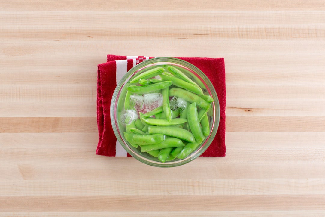 Blanch the sugar snap peas: