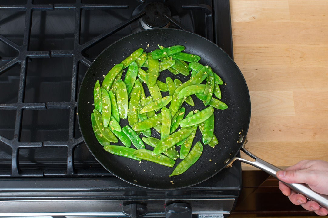 Cook the snow peas & serve your dish: