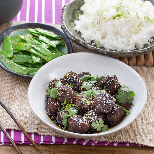 Asian meatballs on snow peas picks