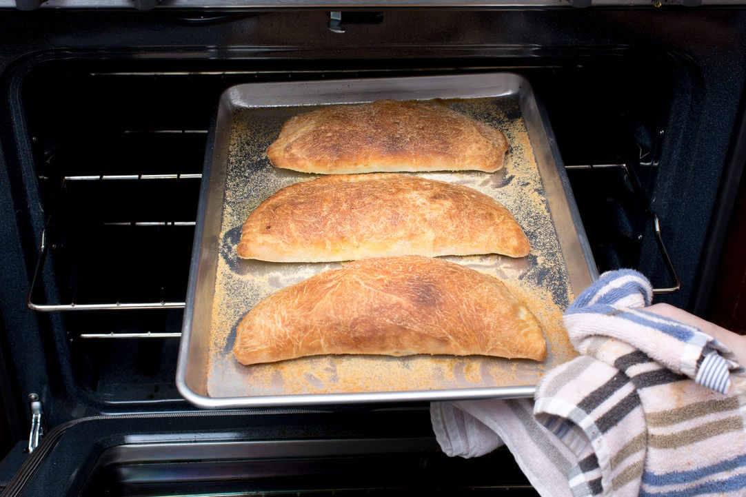Bake the calzones & serve your dish:
