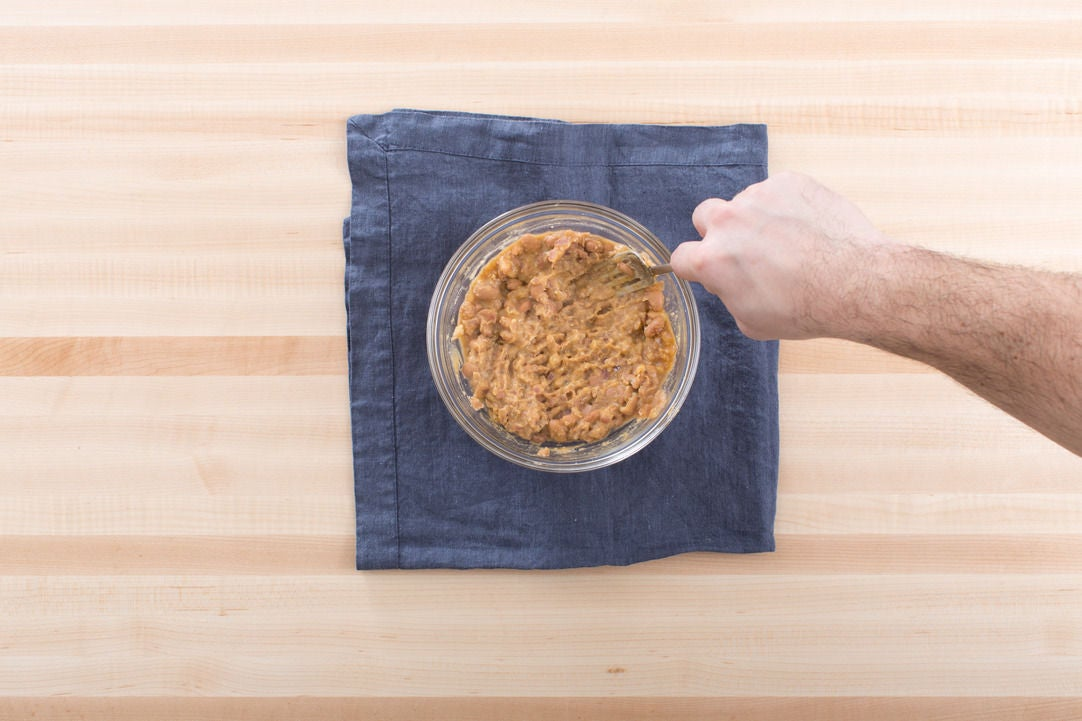 Cook & smash the beans: