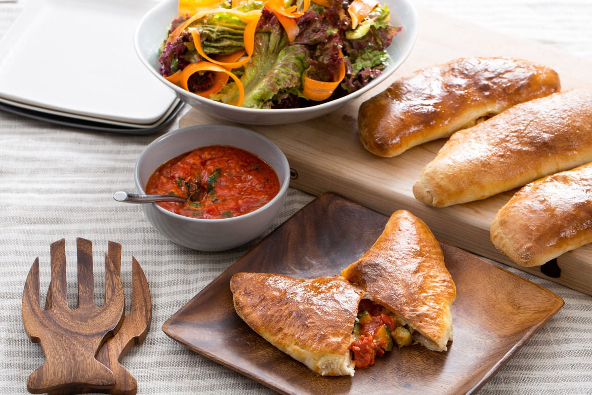 Mozzarella, Zucchini & Basil Calzones with Marinara Sauce & Red Leaf Lettuce Salad
