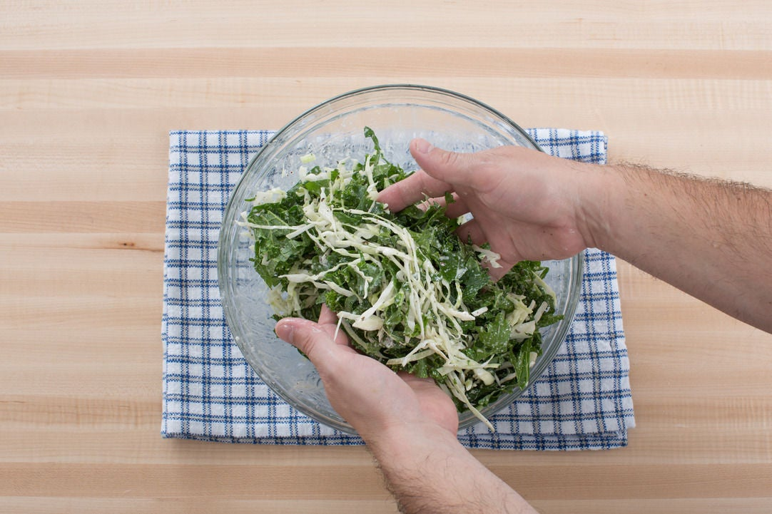 Make the kale-cabbage slaw: