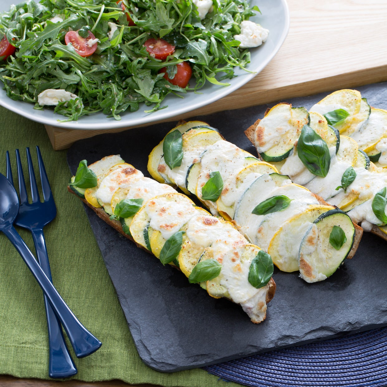 Summer Squash Baguette Pizzas with Arugula & Cherry Tomato Salad