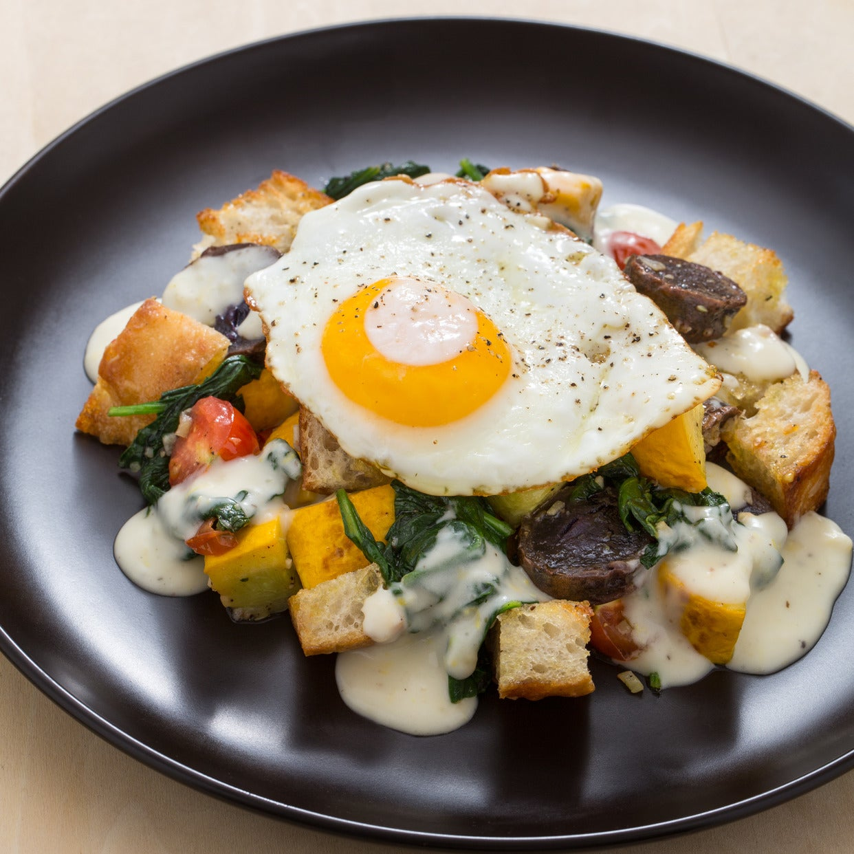Fried Egg-Topped Summer Sauté  with Homemade Croutons & Parmesan Sauce