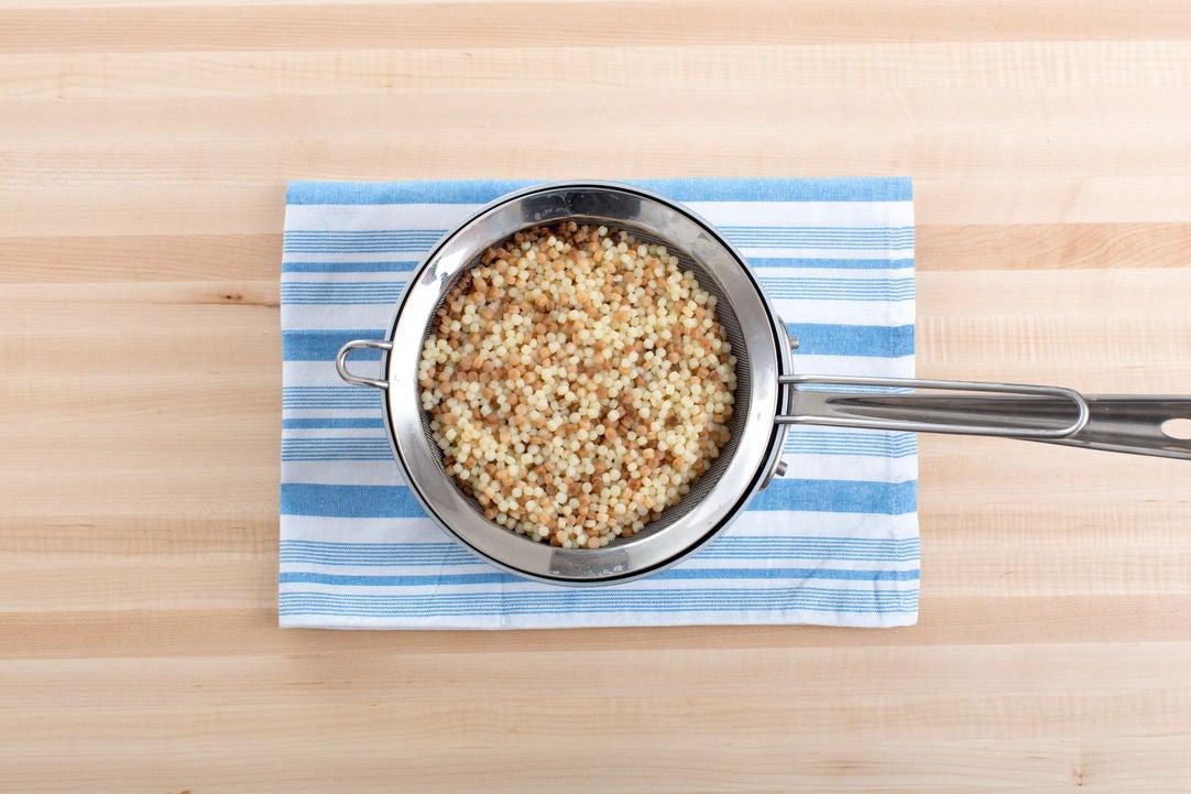 Cook the fregola sarda pasta:
