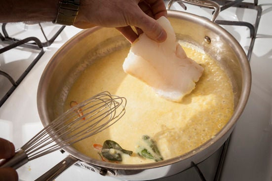 Cook the fish in the curry: