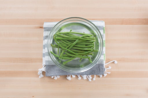 Blanch the long beans: