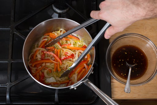 Start the stir-fry & make the sauce: