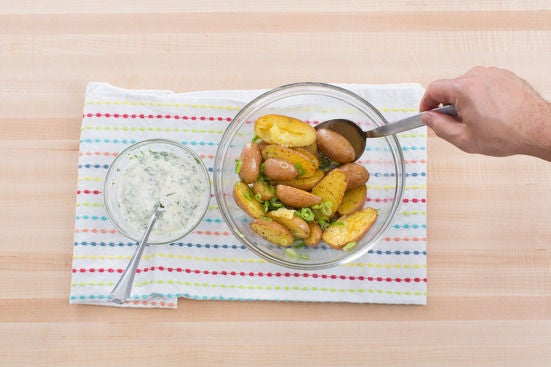 Make the herbed crème fraîche & finish the potatoes:
