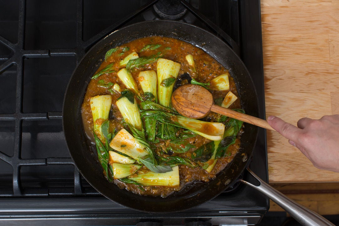 Add the bok choy & finish the curry: