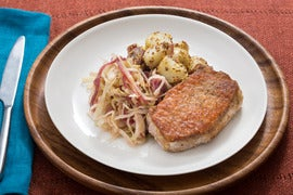 Oktoberfest Pork Chops with Hops-Braised Cabbage & German Potato Salad