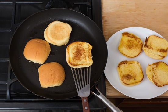 Toast the buns & plate your dish: