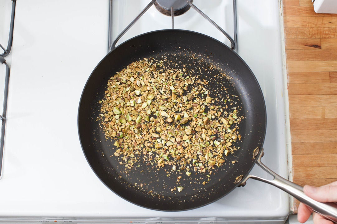 Toast the pistachios and make the herb salsa: