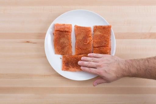 Coat the salmon:
