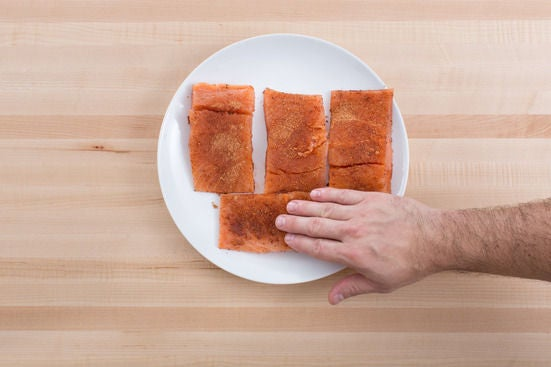 Coat the salmon: