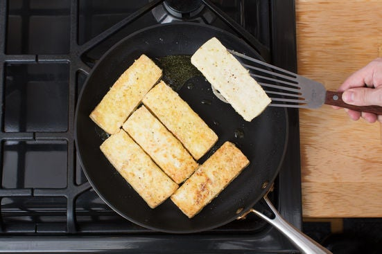 Coat & cook the tofu: