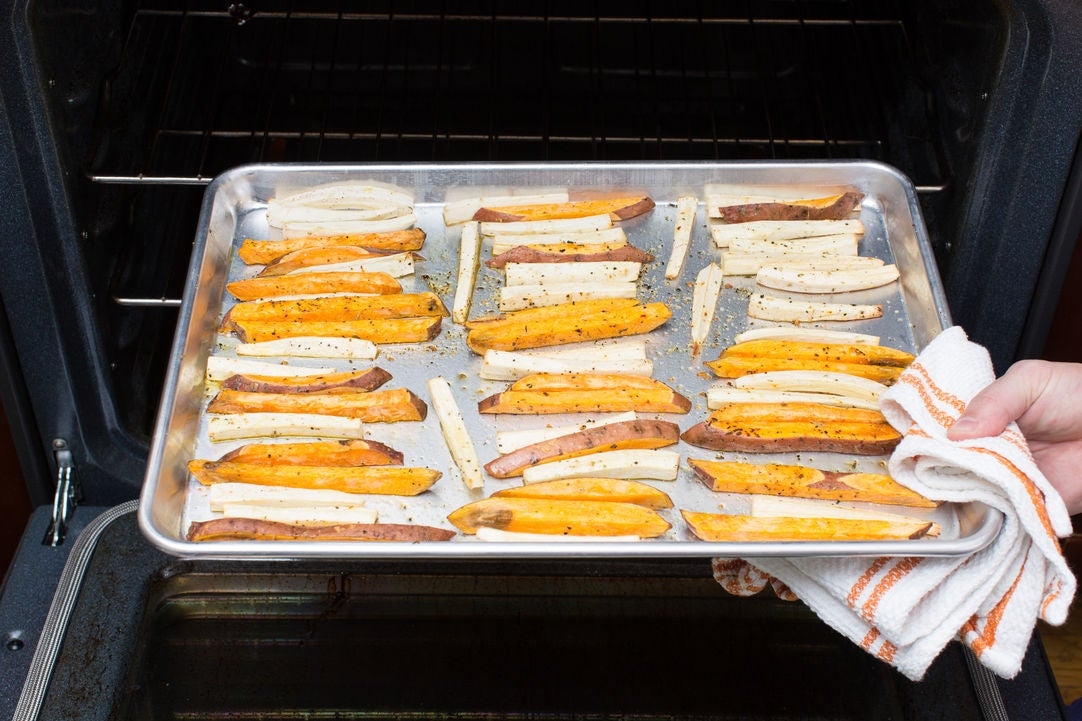 Make the parsnip & sweet potato oven fries: