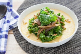 Smothered Two-Cheese Grits with Caramelized Onions & Garlic Kale