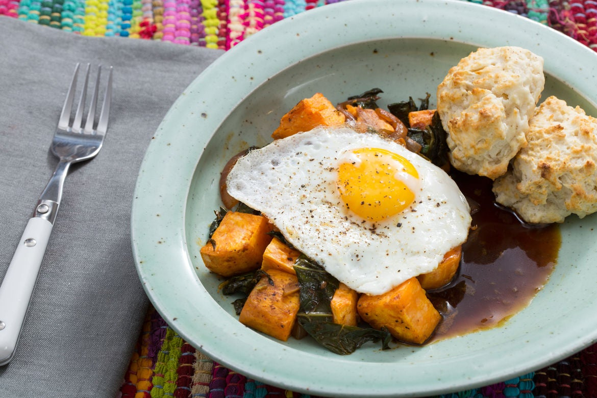 Sweet Potato & Collard Green Hash  with Sunny Side-Up Eggs, Molasses Butter & Biscuits