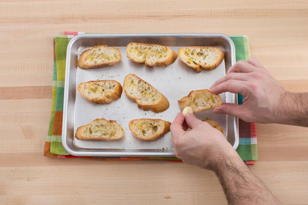 Make the garlic bread & serve your dish: