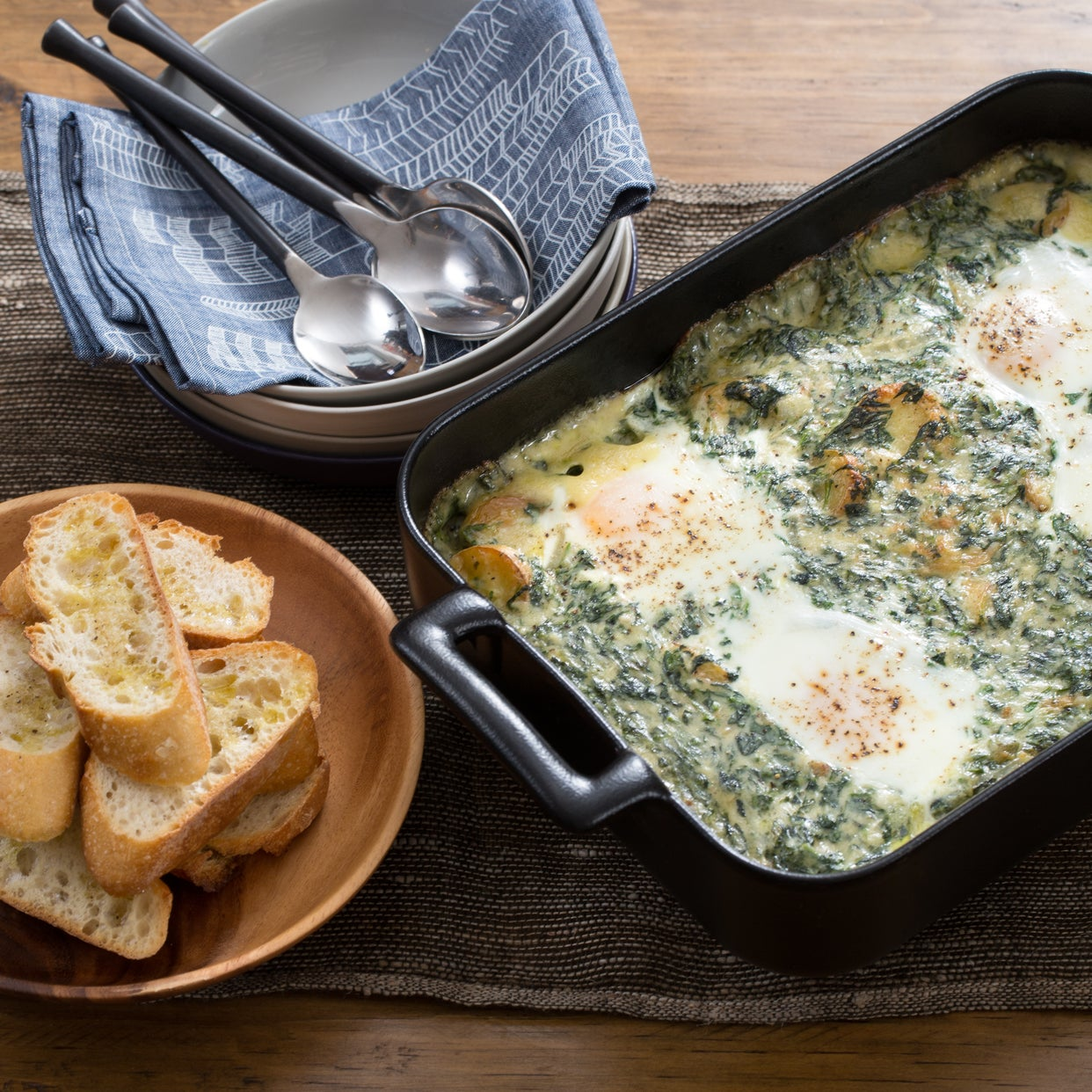 Creamy Fontina & Spinach Baked Eggs with Fingerling Potatoes & Garlic Bread