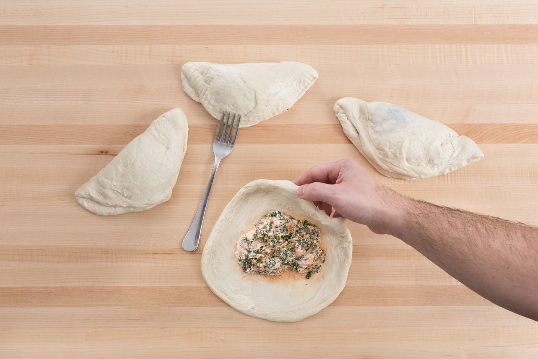 Make the filling & assemble the calzones: