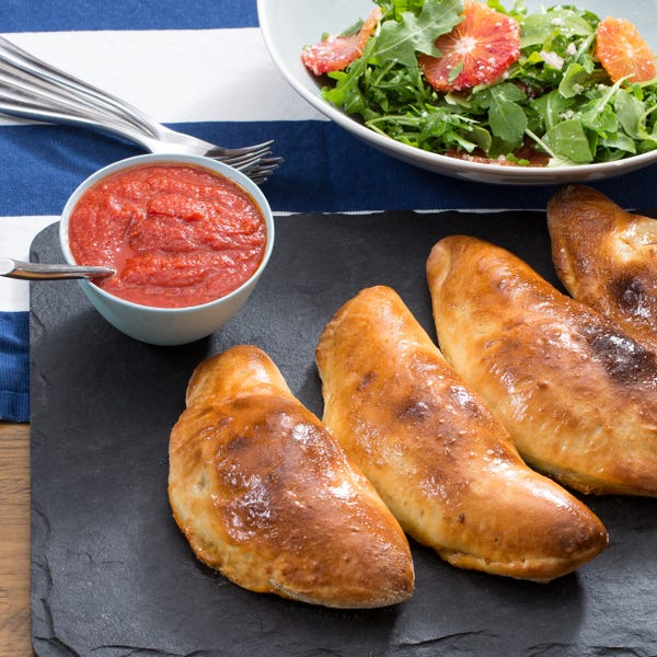 Kale & Ricotta Calzones with Blood Orange & Arugula Salad