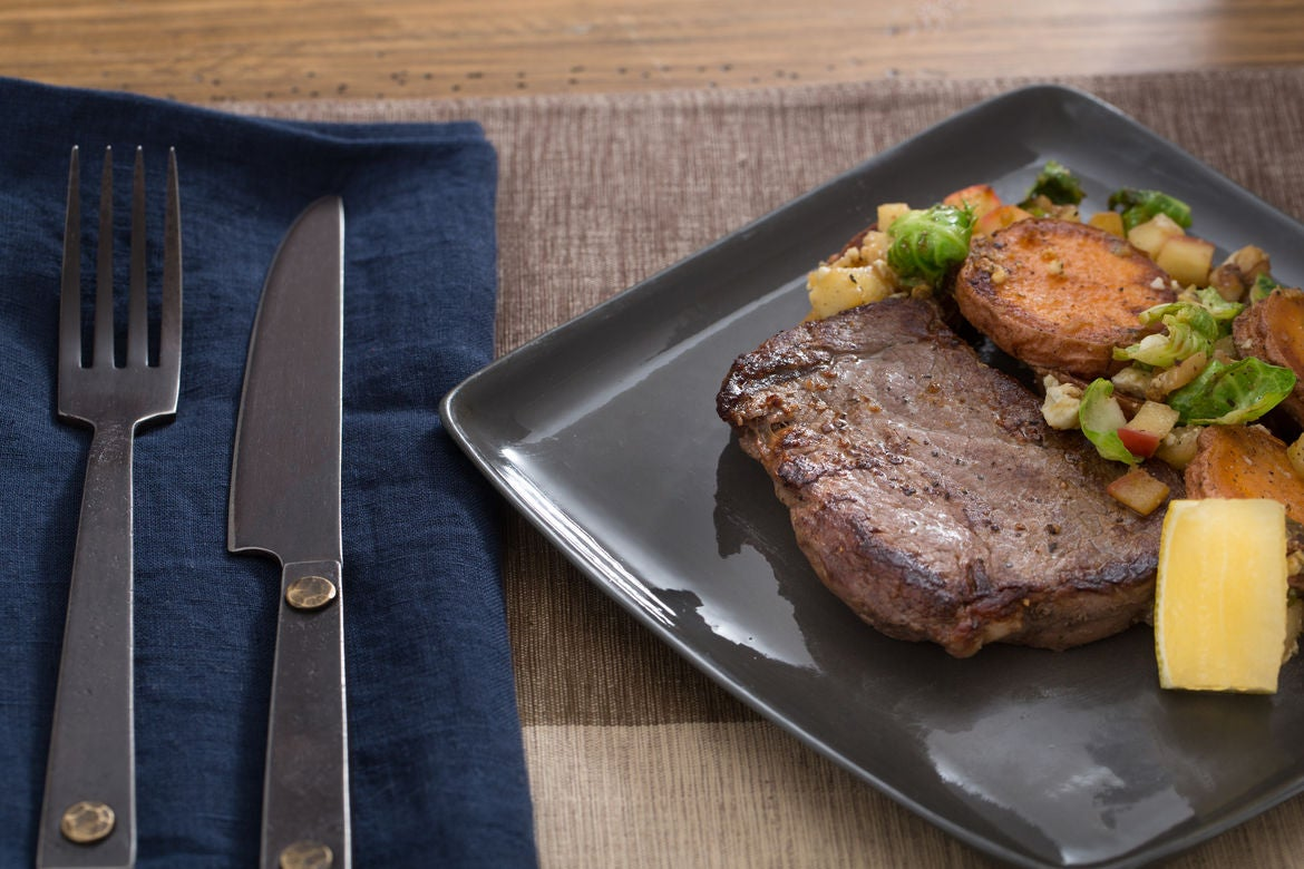 Seared Steaks with Warm Sweet Potato, Brussels Sprout & Walnut Sauté