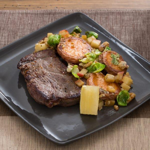 Seared Steaks with Warm Sweet Potato, Brussels Sprout & Walnut Sauté